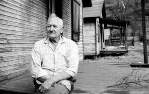 Unemployed miner on porch