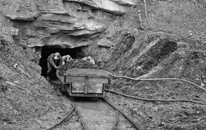 Father and two sons coming out of doghole mine