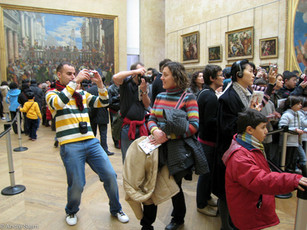 In front of the Mona Lisa at Louvre Paris