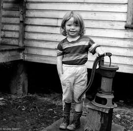 Girl at water pump