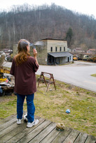 Phyllis Mullins looking at the old general store