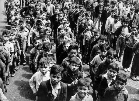 Children forming lines
