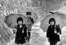 Three kids with umbrellas