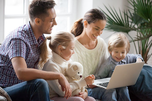 Young family with adopted children using
