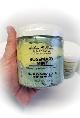 Rosemary Mint Sugar Scrub in container being held by hand.