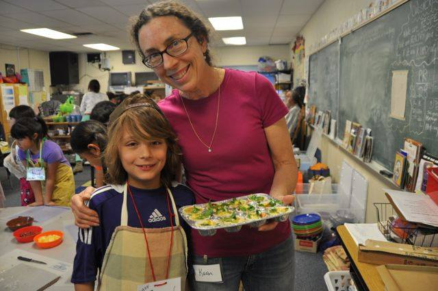 nutrition education teacher and a student in a classroom