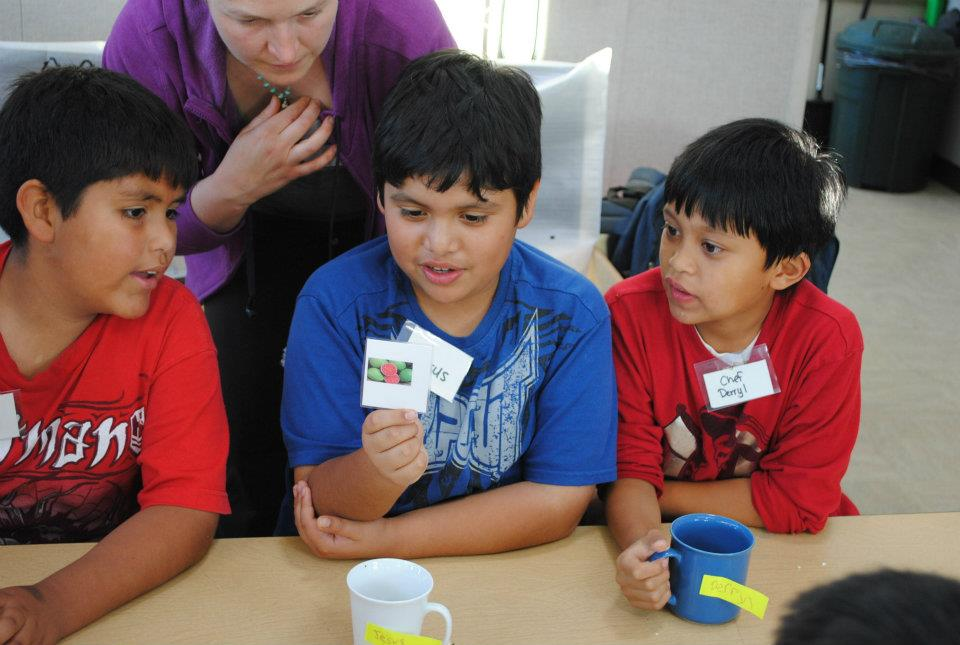 3 boys playing a game to learn nutrition information