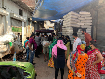 Women in the red light area in Mumbai lining up to receive their care package