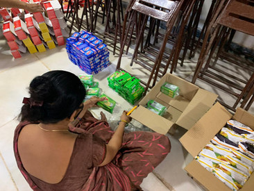 Volunteers help make care packages for the less fortunate