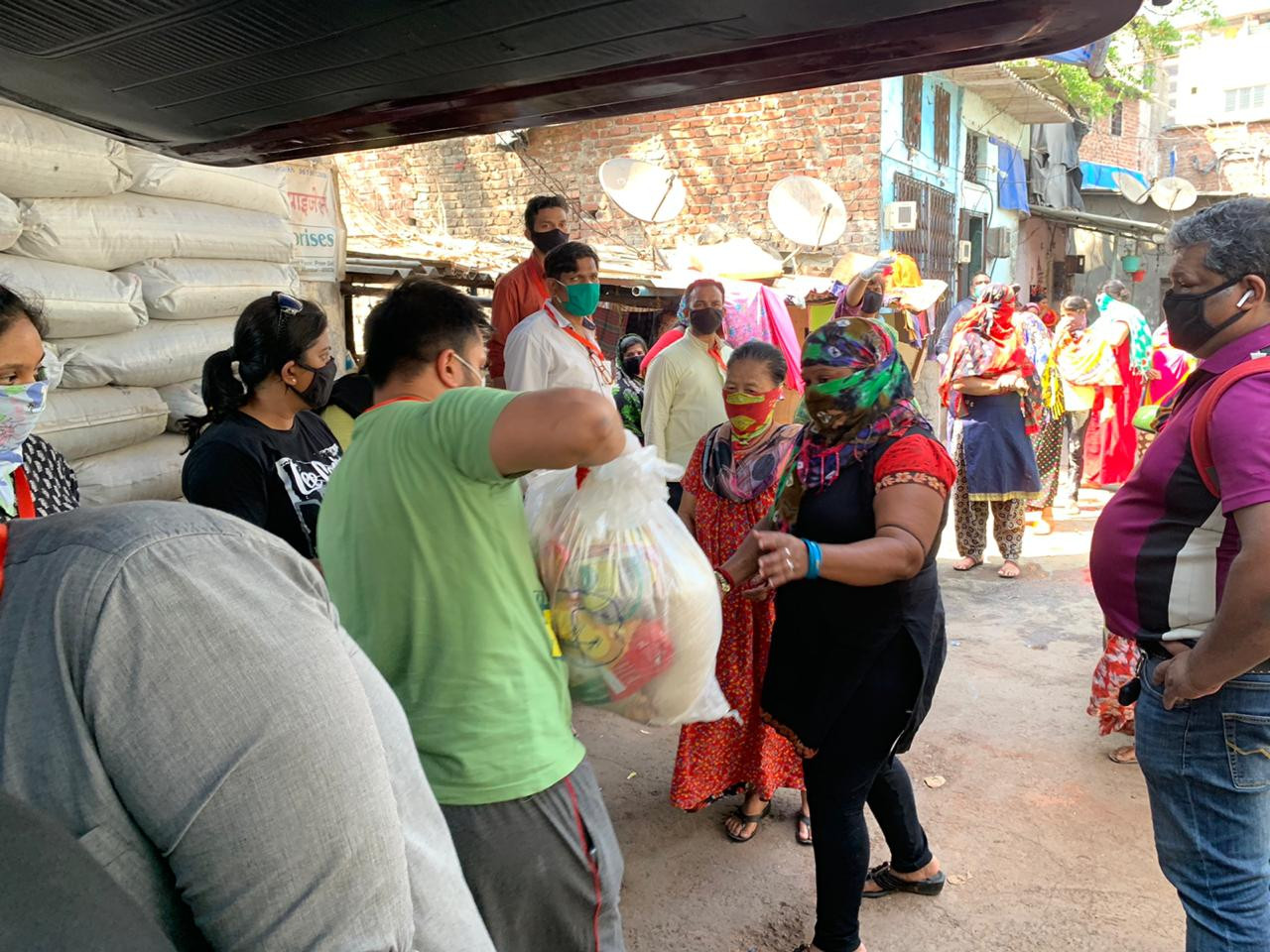 Women of the red light area in Mumbai line up to receive their care package
