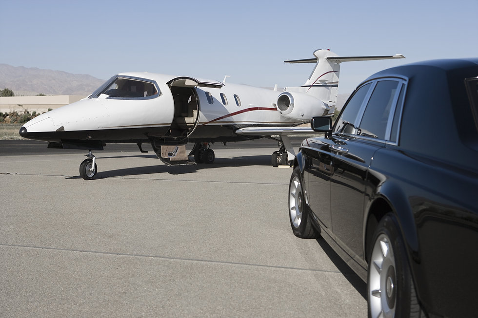 Limousine and private jet on landing str