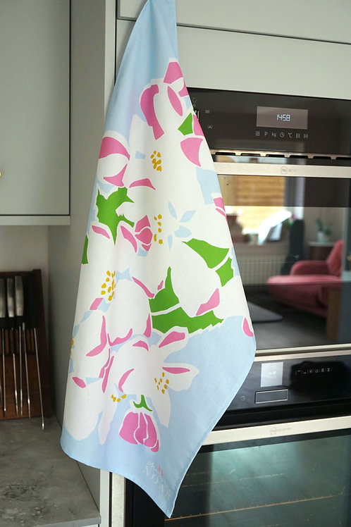 apple blossom tea towel hanging in a kitchen