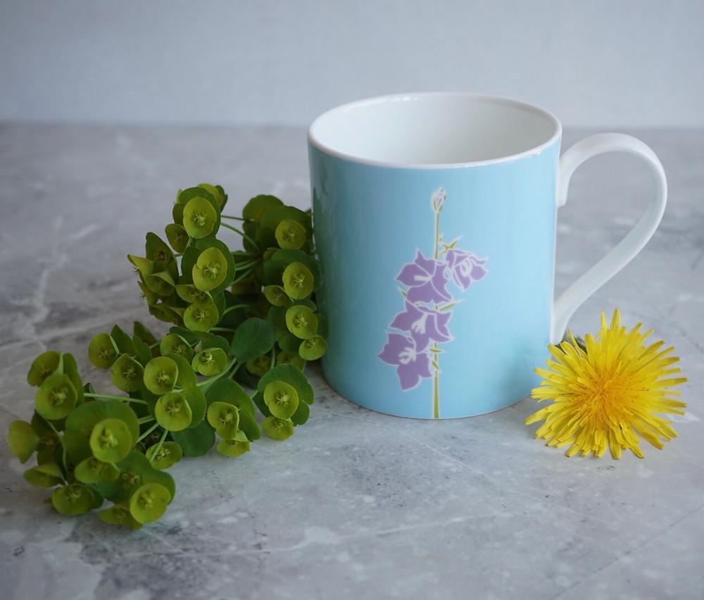 A fine bone china mug with Euphoriba and Dandelion flower