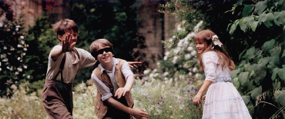 three children playing in a garden
