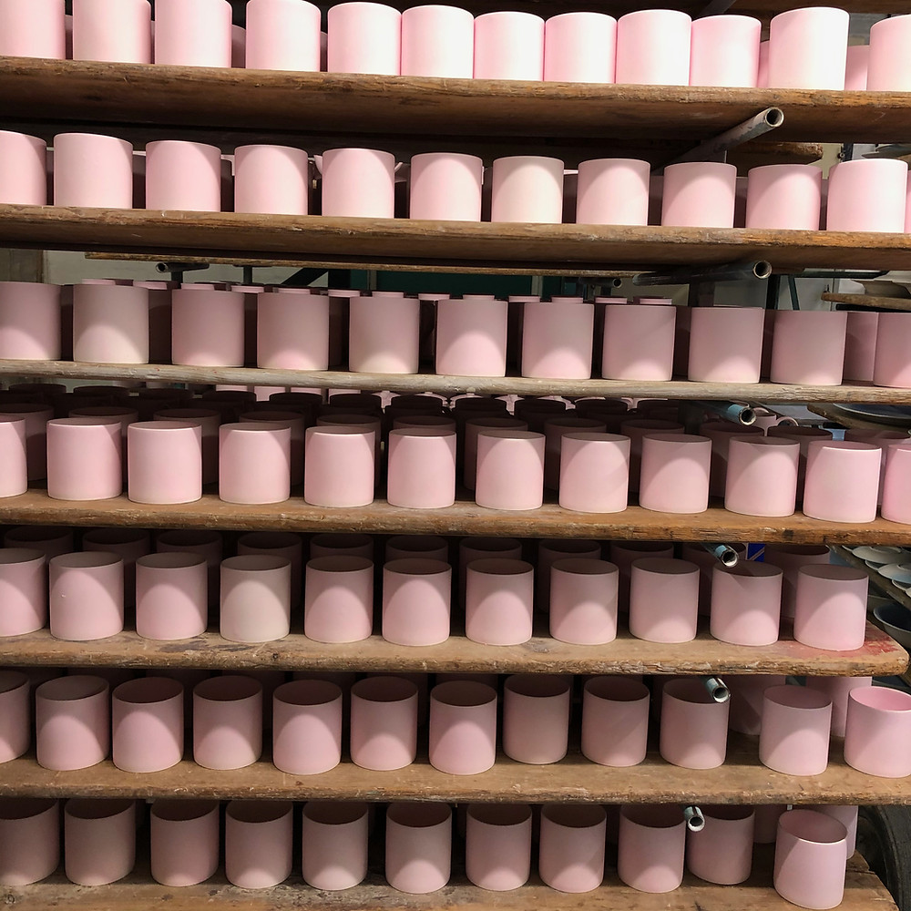 shelves of mugs at a pottery