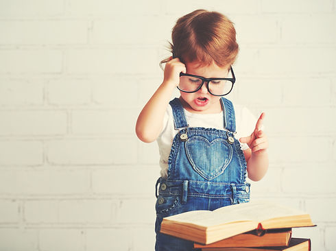 Child Little Girl With Glasses Reading A