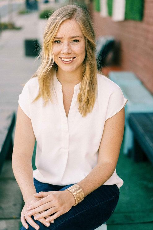 Elizabeth Keri of Watts Filmmaking, a wedding and commercial videographer in Greensbro North Carolina, smiles at camera