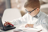 Canva - Smart little businessman using l