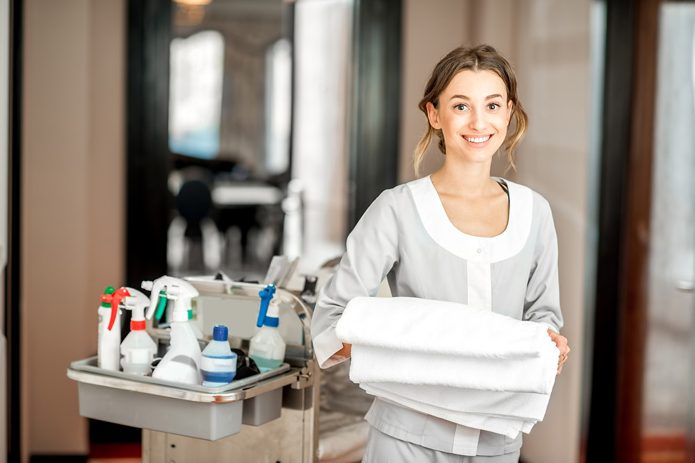Housekeeper Cleaning Florida Beach Hotels, Homes, and Condos