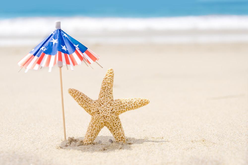 Starfish under US Flag Umbrella at Beach
