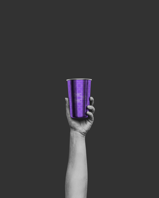 Hand Holding Metal Cup.png