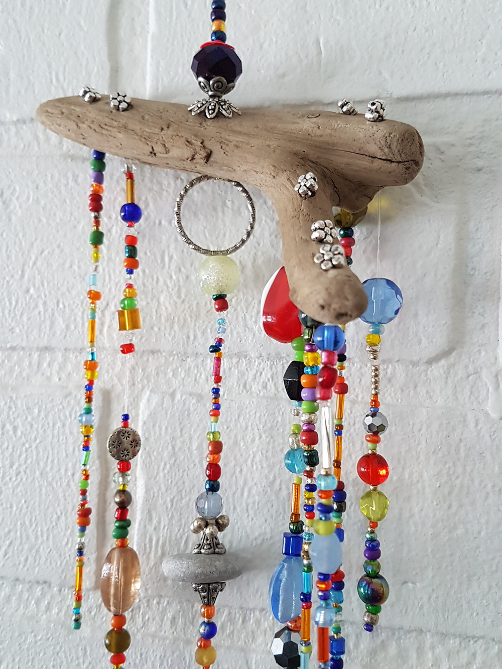 crystal suncatcher on driftwood with beads