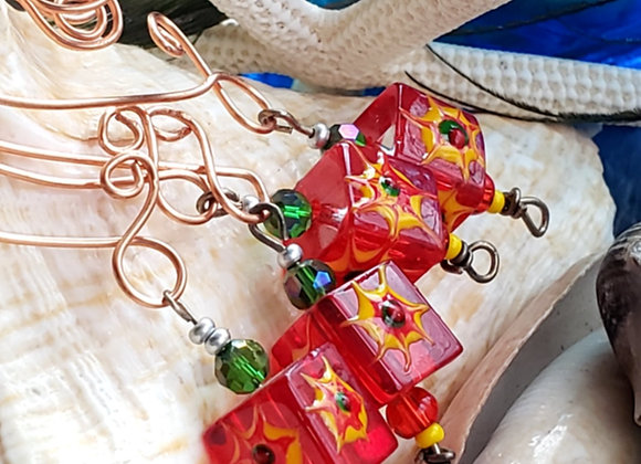 christmas ornaments with bright red square beads on copper wire hooks