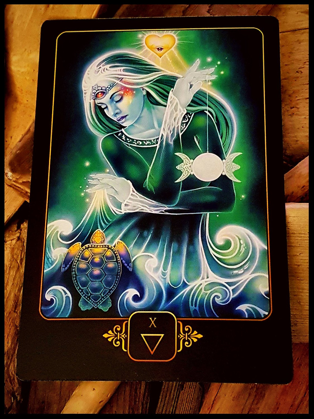 a tarot card with a symbol of a woman, symbolizing universal love, divine connection to celebrate international womens day march 8