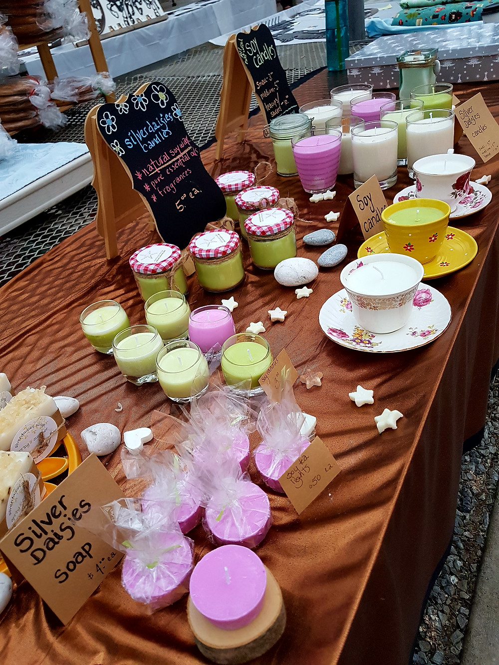 soy candles placed on a table at a market in saint john cedarcrest