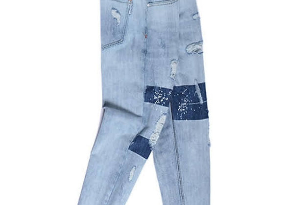Distressed patchwork jeans with rips