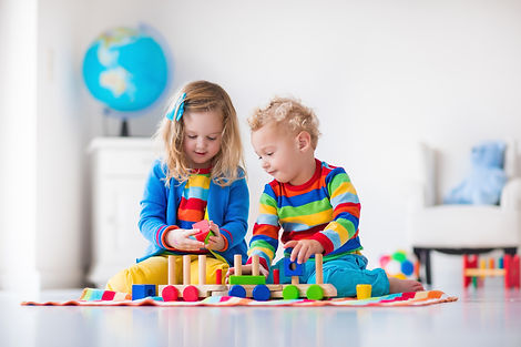 Kids-playing-with-wooden-toy-train-50048