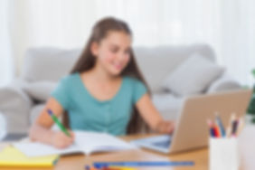 Little-girl-doing-her-homework-at-home-4