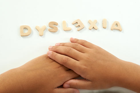 hands-of-a-girl-form-the-word-dyslexia-525913091_6016x4016.jpeg
