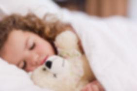 Girl-sleeping-with-her-teddy-137352561_5