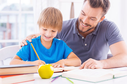 Helping-son-with-schoolwork.-498704079_7360x4912.jpeg