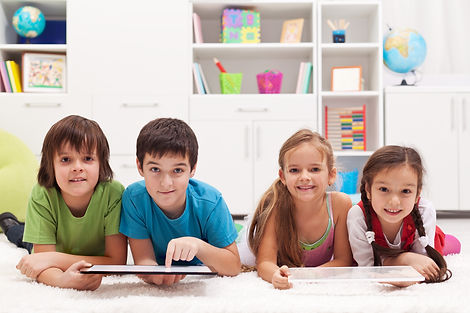 Happy-kids-with-tablet-computers-4605898