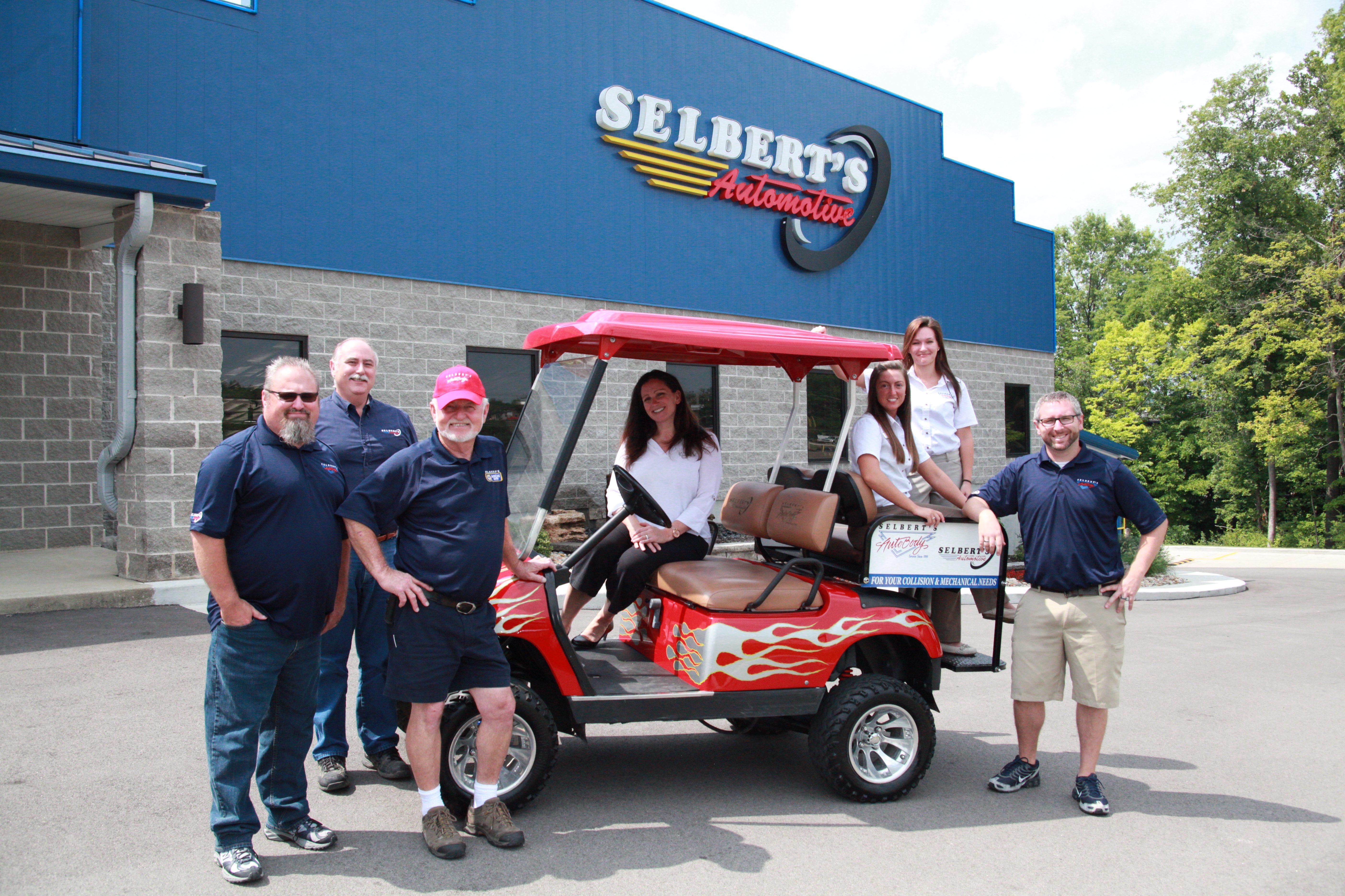 Selbert's team on golf cart