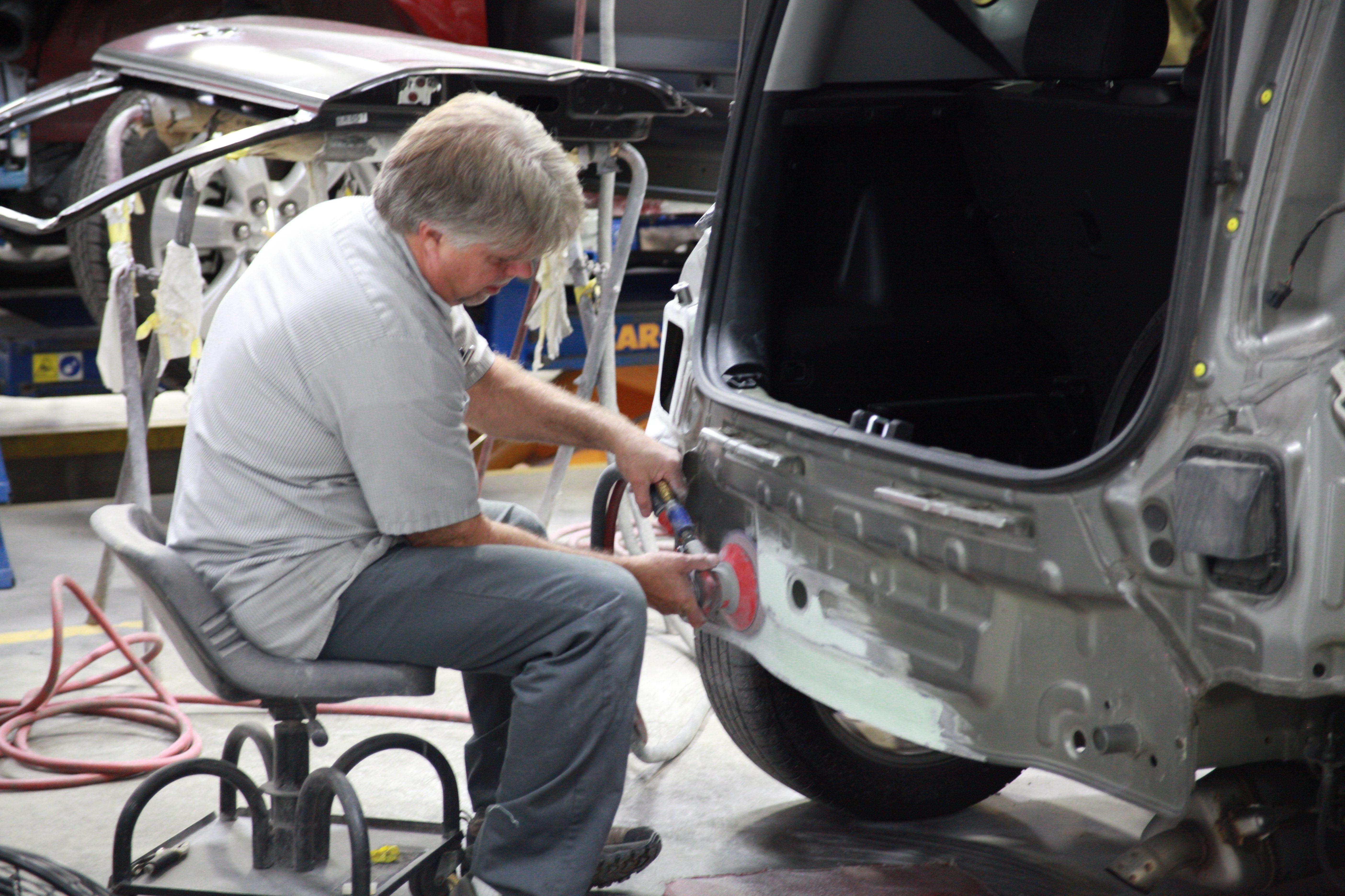 Tech performing collision repair