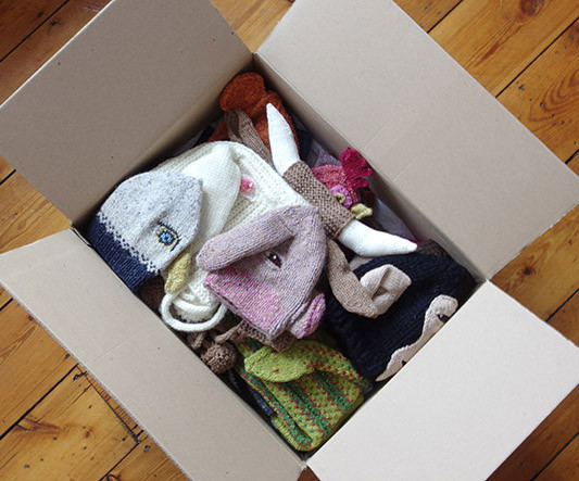 Knitted animal hats in box.jpg