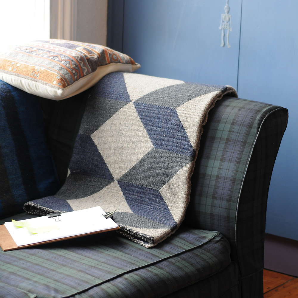 Knitted blanket designed by Lisa Watson