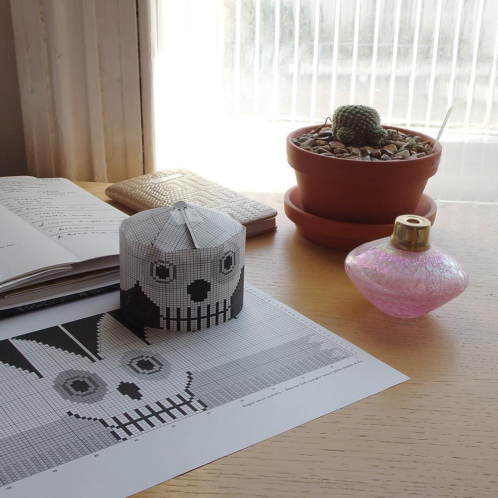 Paper hat on desk