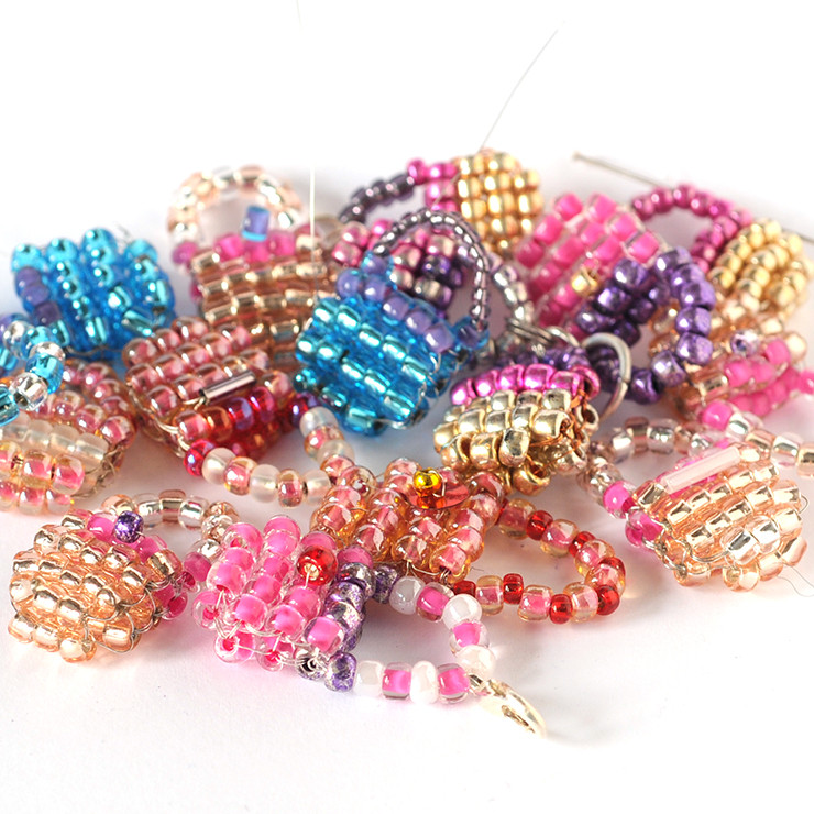 Pile of small handbags made from beads