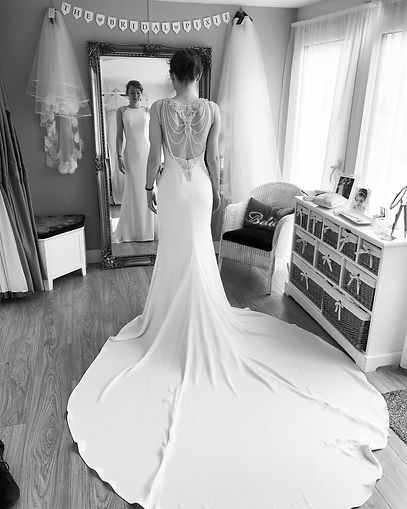 Bride wearing a backless beaded gown