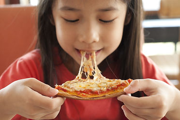 Thai girl enjoy eating pizza..jpg