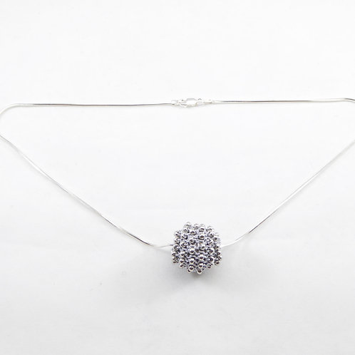 Urbanknits silver hand-knit beaded ball on an Italian sterling silver chain.