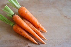 Close up fresh and sweet carrot on  wood