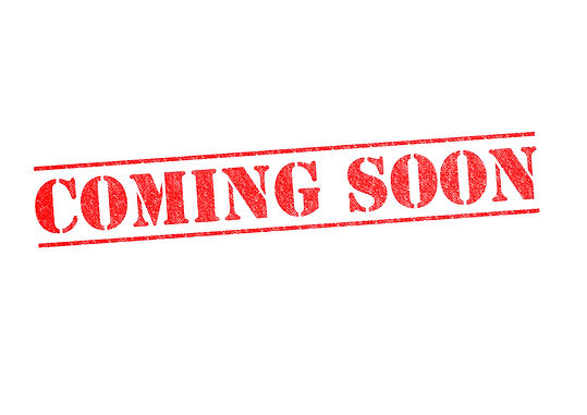 COMING SOON rubber stamp over a white ba