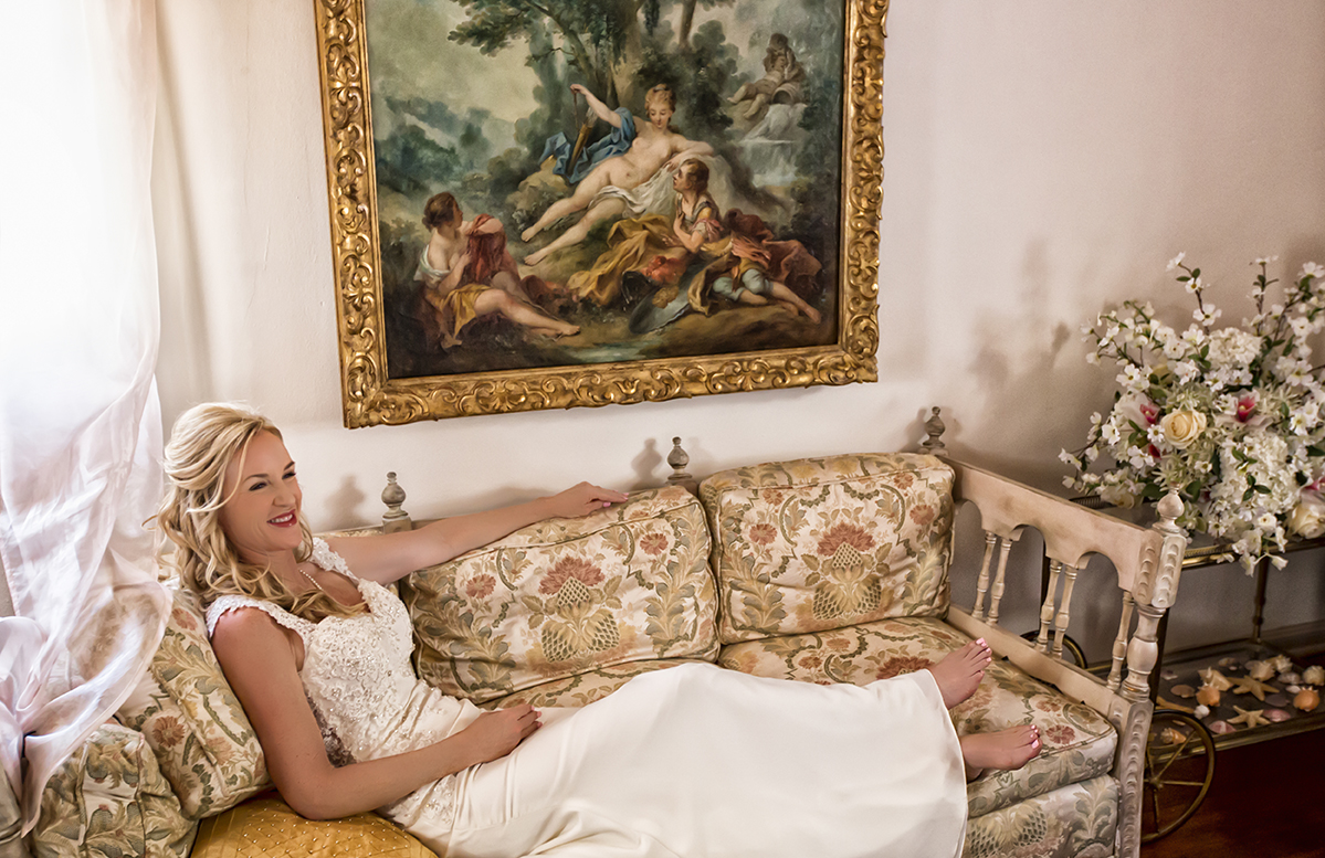 a bride relaxes in her suite at the Wrigley Mansion. Photograph by Rachel Leintz, Wedding Photographer