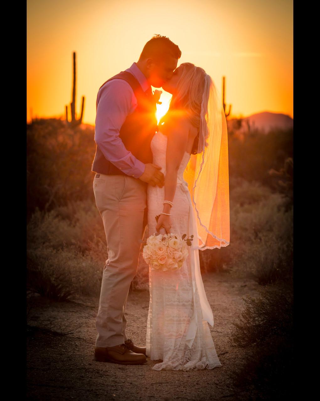 Emily and Matt kiss during sunset. Photograph by Rachel Leintz, Wedding Photographer