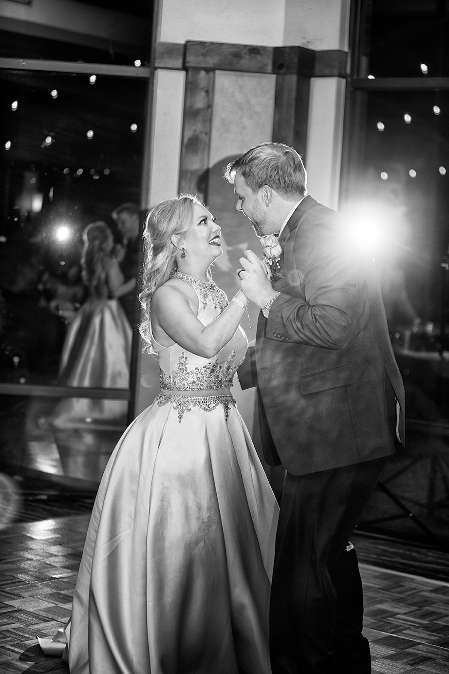 backlit off camera flash creates a flare during a first dance
